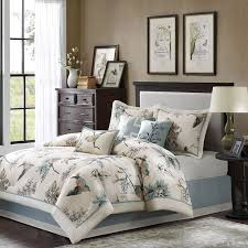 this casual comforter uses warm tones of brown and blue to create a fun leaf and