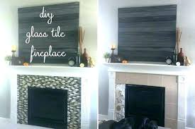 white tile fireplace black and glass tiles surround