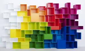 enormous rainbow cubit modular shelving installation multi coloured