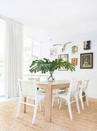 shabby chic dining room woven leather french dining chairs in white long wood dining table white walls juted area rug of french provincial dining set