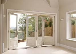 white timber bifold doors internal open