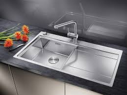 image of luxury undermount stainless steel kitchen sink with drainboard