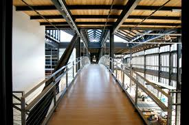 pixar office. hall in pixar office with light brown wooden floor and several silver handrail made from stainless steel photos gallery