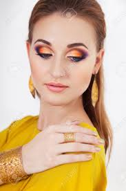 portrait of young beautiful with make up wearing long yellow dress stock photo 40323193