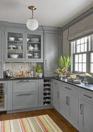 gray kitchen cabinets with black countertops kutskokitchen