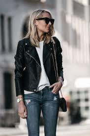 blonde woman wearing nordstrom anniversary black leather moto jacket denim skinny jeans fashion jackson dallas