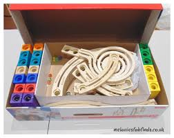 the pieces are all made from wood and most of the blocks are brightly coloured the quadrilla marble run