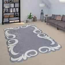 Wohnzimmer Teppich Blumen Bordüre Grau Weiß