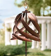 solar copper colored metal wind spinner