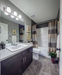 bathroom update ideas. Ideas To Update A Fibreglass Tub And Shower Surround With Dark Subway Tile By Stepper Homes Bathroom