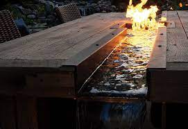 Outdoor Dining Table Meets Fire And Water Pond Trade Magazine