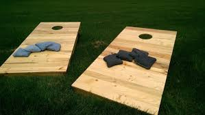 Wooden Corn Hole Game 100 Outdoor Game Ideas for your Next Party Magnolia 16