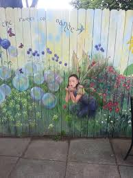 Fairy blowing bubbles in garden mural