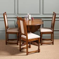 compact dining furniture. Classic Drop Leaf Dining Table For Small Spaces With Fabric Wooden Seat Plus Jute Rug To Compact Furniture