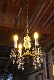 small brass 4 light crystal chandelier