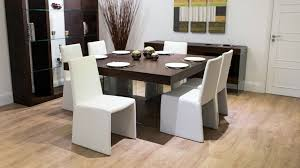 glass legged 8 seater dining table and contemporary chairs