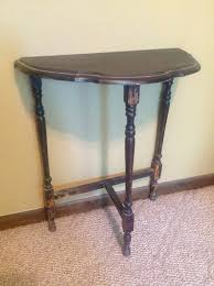 antique half round table image and candle victimist
