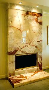 marble and granite fireplace surrounds this polished onyx fireplace and hearthstone by l stack fine marble