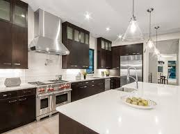 white quartz counter kitchen dark cabinets in a european style