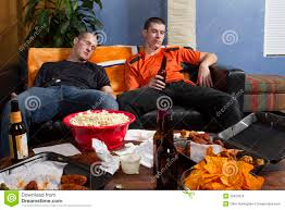 two tired men after watching sports game on tv horizontal royalty two tired men after watching sports game on tv horizontal
