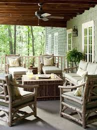 a cozy rustic patio with wooden furniture a stick side table and coffee table plus