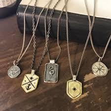 for the man who likes to travel and explore the compass and explorer necklaces make a meaningful gift emblazoned with the symbol of the compass