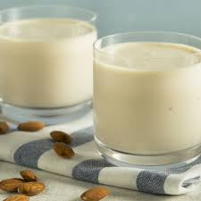 delicious protein shakes in glasses surrounded by almonds
