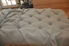 handmade diy square tufted ottoman bench with gray fabric cover for small rustic living room spaces ideas