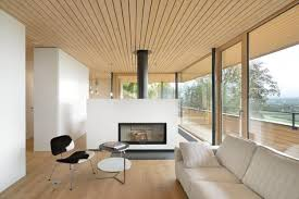 Modern interior design with wooden architectural features and a wood stove  as a room divider