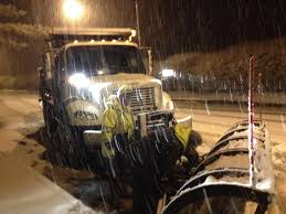 cky department of highways crewmen on the road in rowan county wednesday night during the snow pulled over as a mechanic works on a plow blade
