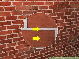 image titled hang something on brick step 3