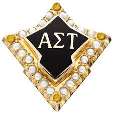 cpbadge yellow topaz the emerald badge is worn by alpha sigma tau