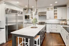 white shaker cabinets with quartz countertops. high end stainless steel appliances, white marble countertop on a grey island, custom shaker cabinetry with black quartz countertop, cabinets countertops r