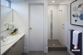 the paradiso bathroom features dark floor tiles classic white wall tileulti coloured