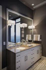 modern bathroom lighting luxury design. Bathroom:Bathroom Lighting Design Mixed With Luxury White Triple Wall Sconces And Beautiful Flowers On Modern Bathroom R