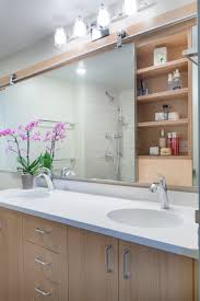 A vanity bathroom mirror with pull-out storage?! Genius! | For The ...