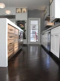 Wooden Floor For Kitchen Dark Kitchen Cabinets With Medium Hardwood Floors Quicuacom
