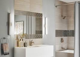 Left - Solace Bath Bar by Tech Lighting  Right - Tigris Oval Recessed  Mirror by Tech Lighting