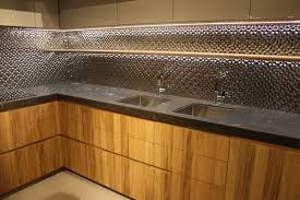 under lighting for cabinets. pocelanosa wood cabinets and stainless steel backsplash under lighting for