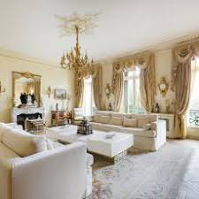 gold curtains living room. lavish victorian living room in paris with white furniture, heavy drapery and gold decorative details curtains o