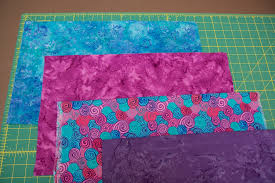 How to make an Interleave quilt | This Thing & Select four fat quarters of four fabrics for the quilt top. They should be  fabrics Adamdwight.com