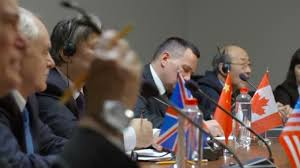 two asian partints of international economic summit friendly discuss a question at round table