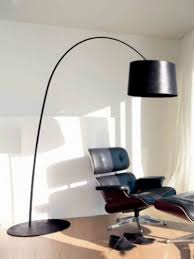 black curved floor lamp with black shade