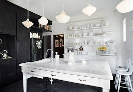 view in gallery interesting contrast between black and white in the kitchen