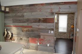 they did a feature wall as well as a kitchen island lots of life and colour in the room now with the pop of the red barn board