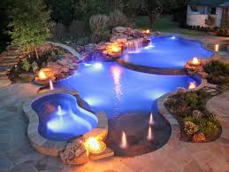 pool waterfall lighting. #SwimmingPools #Pools Natural Edge Pool With Spa, Slide And Waterfall By Distinctive Pools Lighting E