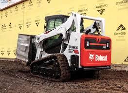 manuals bobcat company bobcat t595 lifting material at a commercial construction site a bucket