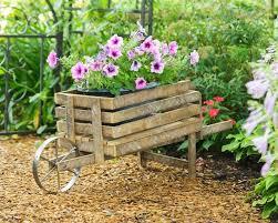 reclaimed wood wheelbarrow planter
