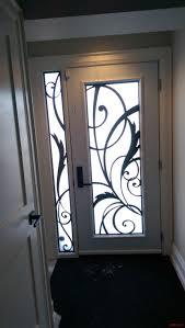 single steel door with a sidelite with modern lasercut metal door inserts