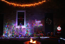 12 Ways To Use Your Christmas Lights In The Summer  Southern LivingChristmas Lights In Backyard